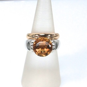 Citrine engagement ring with yellow gold wedding ring fitting in closely